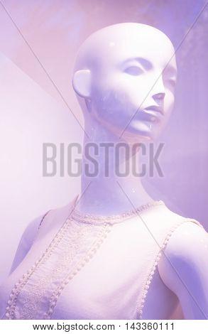 Store window fashion retail shop female mannequin bald dummy.