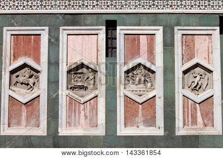 Hexagonal reliefs on the Giotto Campanile of Florence Italy. The hexagonal panels on the lower level depict the history of mankind inspired by Genesis