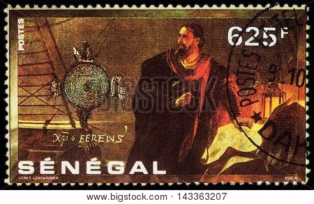 MOSCOW RUSSIA - AUGUST 20 2016: A stamp printed in Senegal shows Christopher Columbus with a map on the ship series