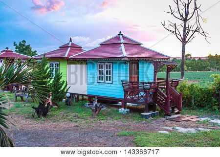 Cute Small Green and Blue Cottage in the Evening