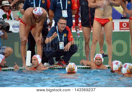 Budapest, Hungary - Jul 17, 2014. Montenegro's PEROVIC Ranko head coach talking about the tactics. The Waterpolo European Championship was held in Alfred Hajos Swimming Centre in 2014.