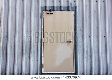 iron door on corrugated metal sheet, industrial concept