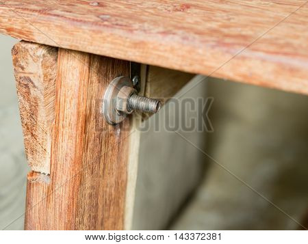 Wood table is fastened with bolts large .