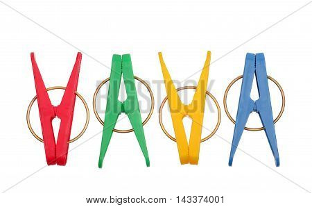Different colors clothespins isolated on white background