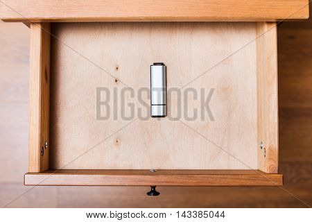 Closed Flash Drive In Open Drawer