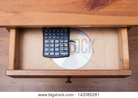 Scientific Calculator And Disk In Open Drawer