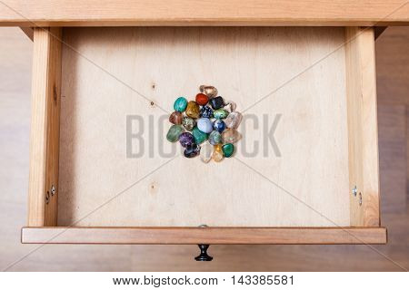 Pile Of Gem Stones In Open Drawer