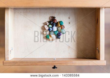 Pile Of Gemstones In Open Drawer