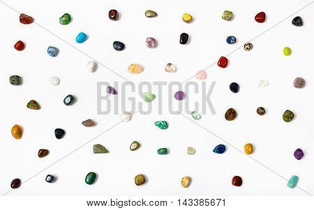 Many Semi-precious Stones Arranged On White