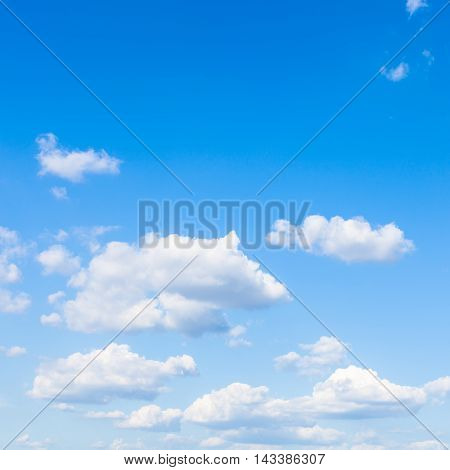Small White Clouds In Blue Sky In Sunny Day