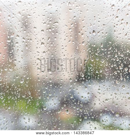 Rain Drops On Window Glass Of Apartment House