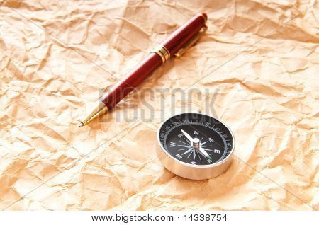 Vintage compass on the paper in adventure concept poster