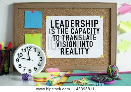 Leadership success concept with motivational quote on bulletin board in office