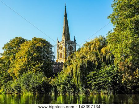 High dynamic range HDR Holy Trinity church seen from River Avon in Stratford upon Avon UK poster