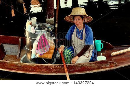 Samut Prakan Thailand - January 15 2013: Vendor selling food from her boat at Ancient Siam and Heritage Park's floaitng market