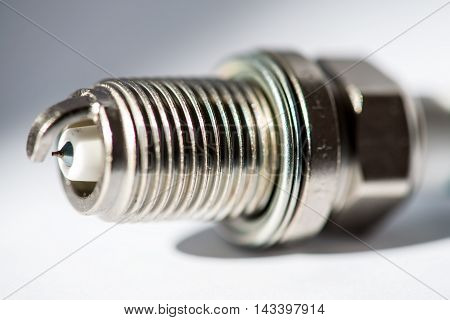 Car spark plug isolated on the white background
