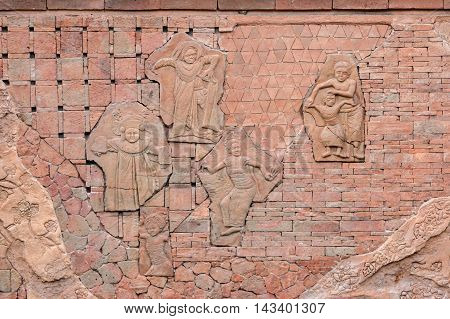 Bali culture stone carving on temple wall .