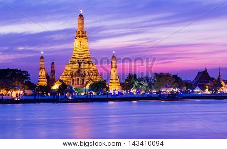 Night view of Wat Arun temple and Chao Phraya River Bangkok Thailand