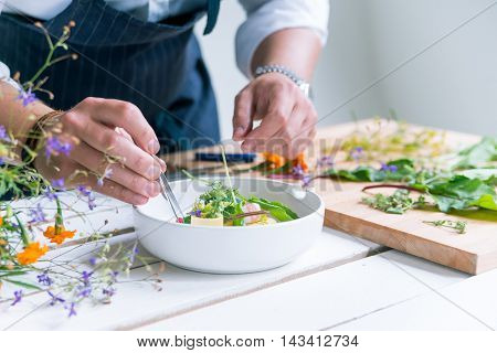 Closeup image of chef cooks delicious meal at luxurious restaurant