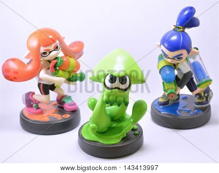 FRANKFURT, GERMANY - August 20, 2016: Splatoon amiibo figures (Inkling Girl, Inkling Squid, Inkling Boy) by video game company Nintendo in front of a white background