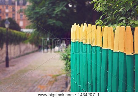 Wooden painted green fence with selective focus