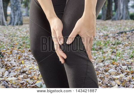 Injuries - Sports Running Knee Injury On Woman. Woman Runner With Pain, Maybe From Sprain Knee.