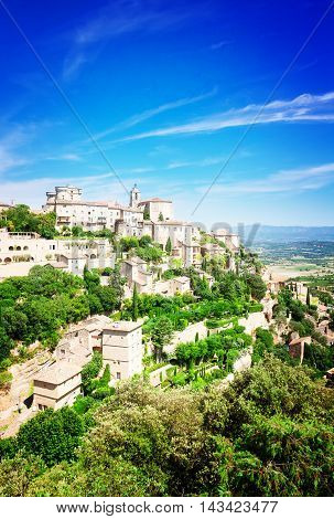 Gordes, old town fortress of Provence at summer day, France, toned