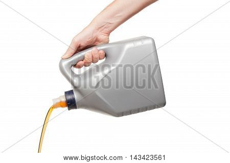 Engine Oil Pouring From A Canister In Hand Isolated