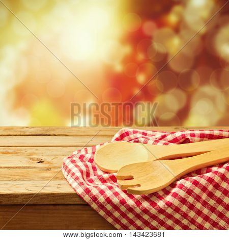 Autumn background with kitchen utensil and checked cloth