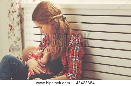 a mother breast feeding her baby toddler poster