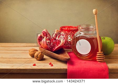 Pomegranate and honey for Rosh Hashanah holiday. Jewish New Year.