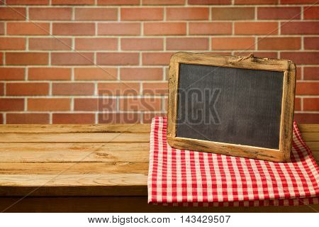 Chalkboard on checked tablecloth. Copy space for your text or message display