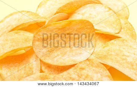 Tasty Gold Potato Chips Background