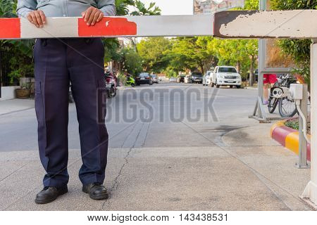Security guard with barrier gate for access control at gateway