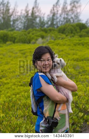 Asia Woman And Her Dog Posing At Mangrove Forrest (thung Prong Thong)