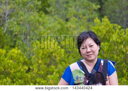 Asia Woman Posing At Mangrove Forrest (thung Prong Thong)