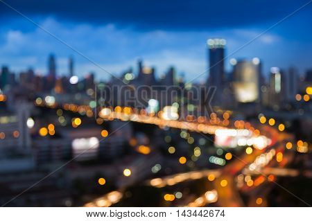 Blurred lights at twilights, city and office building, abstract background