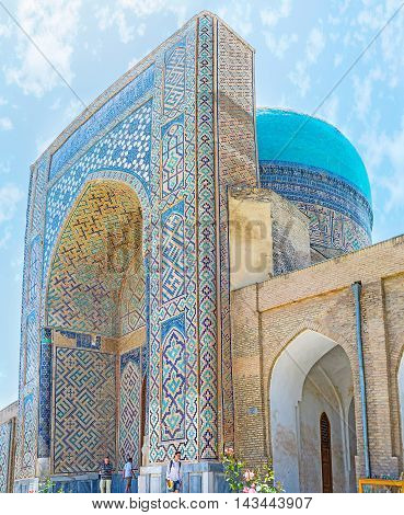 SHAKHRISABZ UZBEKISTAN - MAY 2 2015: The gate of the Kok Gumbaz (Blue Dome) Mosque decorated with the islamic patterns of the colorful glazed tile on May 2 in Shakhrisabz.