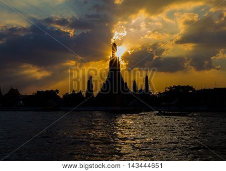Silhouette of Wat Arun Temple along with Chaopraya River, Bangkok Thailand Landmark