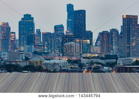 Opening wooden floor, Aerial view city downtown twilight time