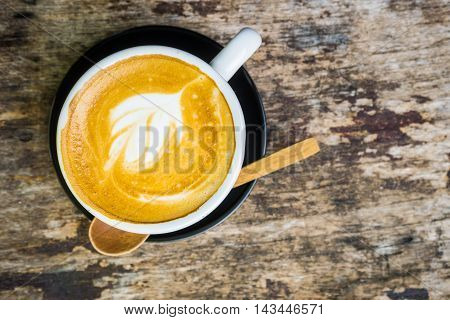 Top View Of Late Art Coffee On Wood Background
