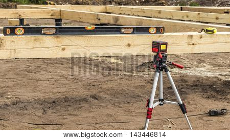Laser measuring tools on a construction site level