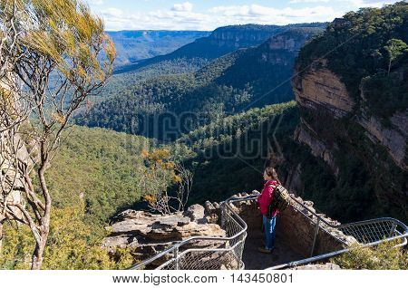 Observation Deck With Woman Looking At Mountains View