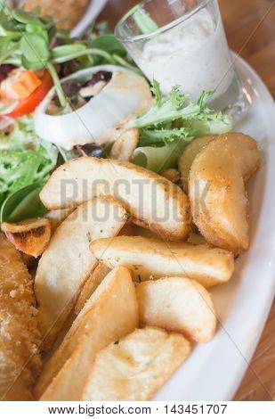 Gourmet fish and chips with salad stock photo