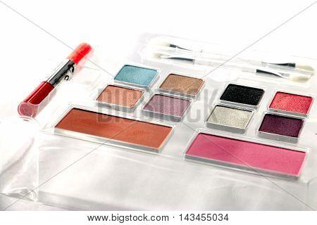 colored mascara face into a set of cosmetics