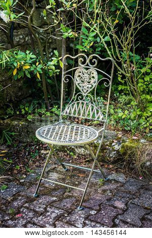 Vintage iron chair for garden in a green relaxing corner