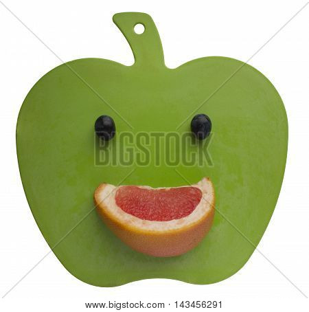 happy smile on green carving board isolated