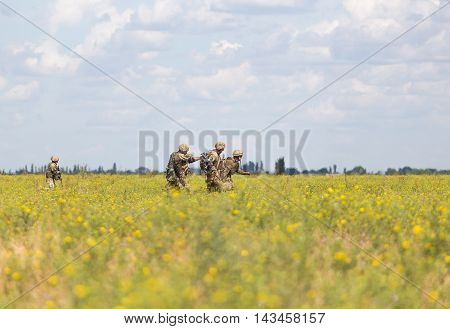 Mykolaiv, Ukraine - July 21 2016: Ukrainian soldiers running to evacuation point with wounded comrade during the international military exercises Sea Breeze launched in Odesa and Mykolayiv regions