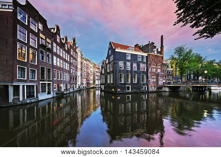 View of Amsterdam canal at sunset Netherlands