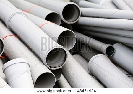 A lot of grey PVC sewer pipes